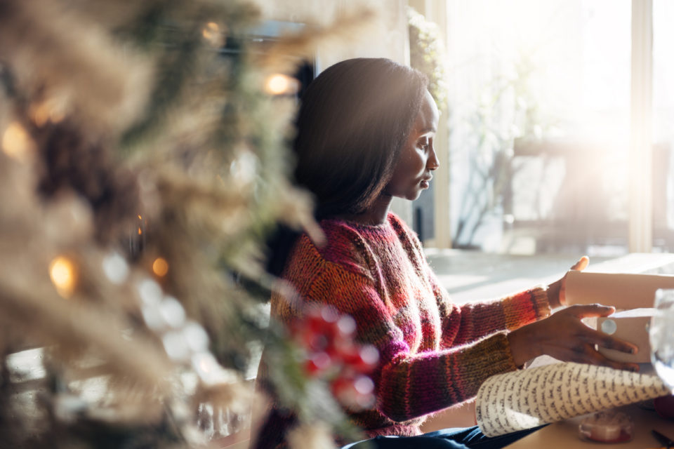 Woman wrapping Christmas gifts,