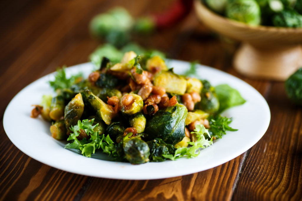 Brussels sprouts fried with beans close-up