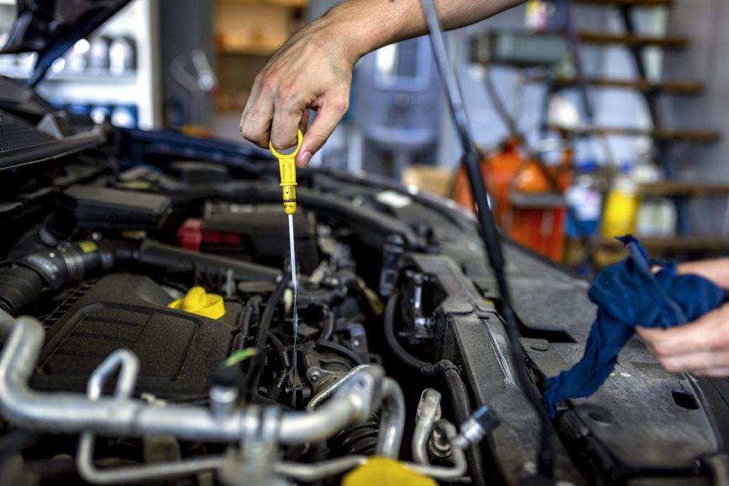 Mechanic checking oil