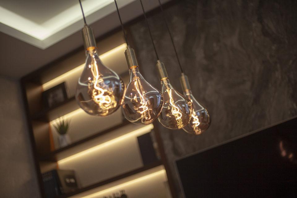 Big yellow modern bulbs in a luxurious room.