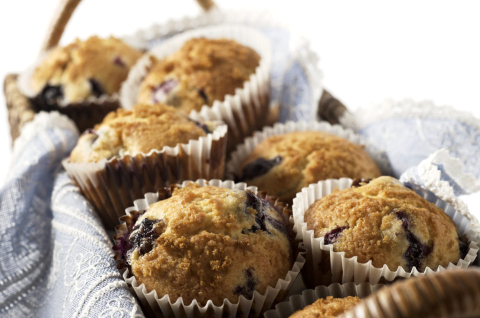 Close-up of blueberry muffins in rectangular basket