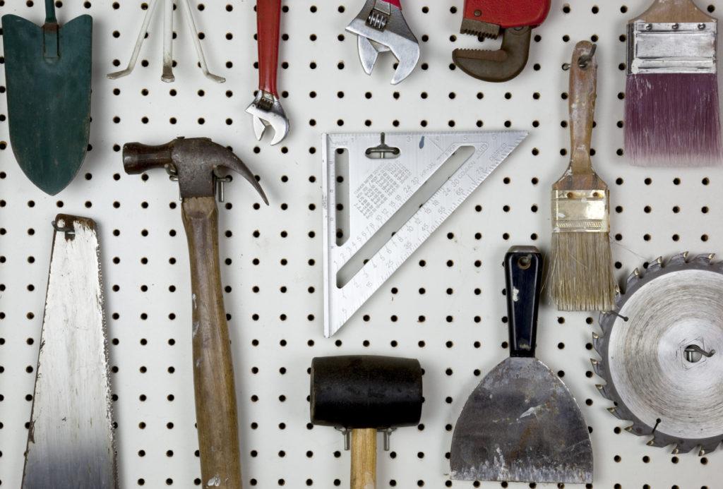 Tools organized on a garage pegboard