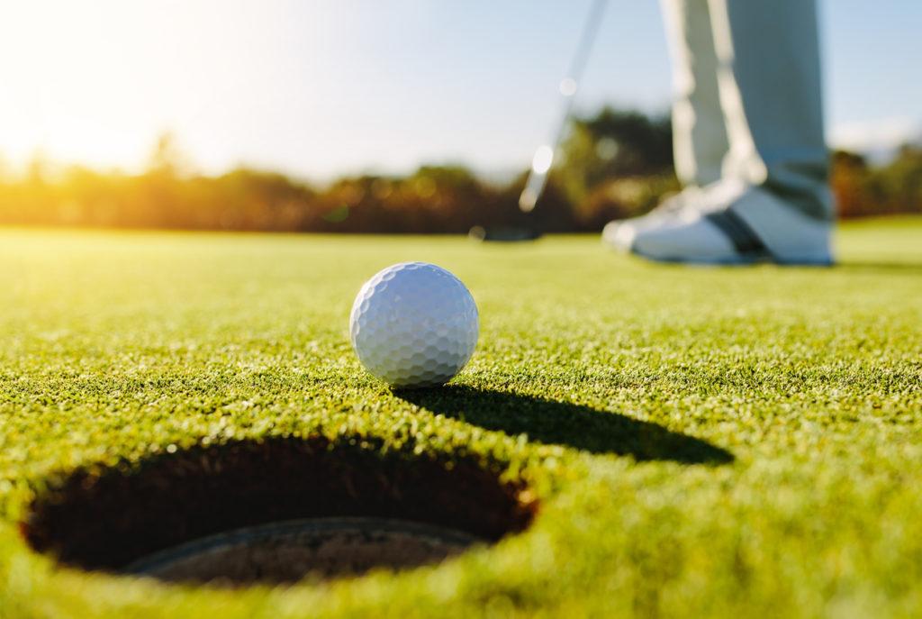Golfer putting ball