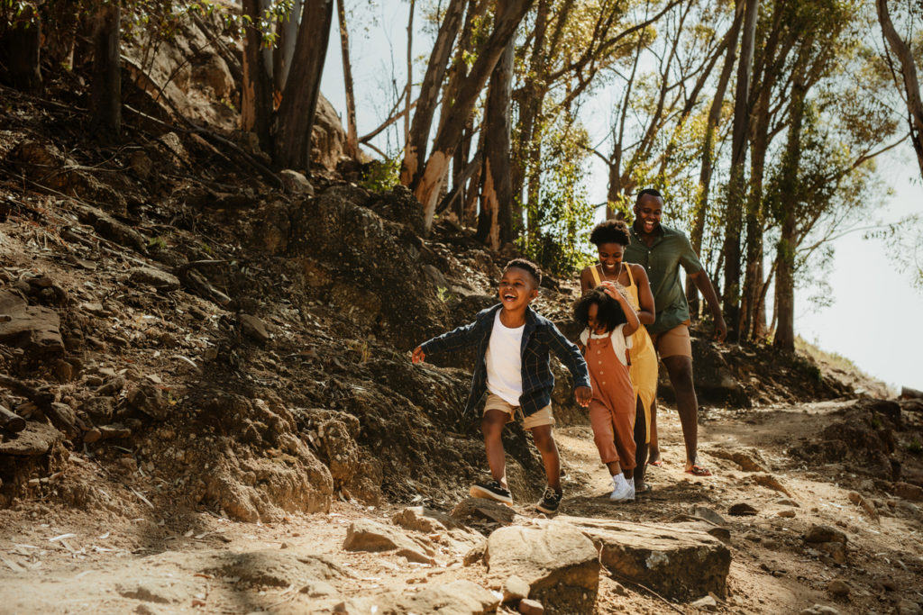 Family running down rocky trail